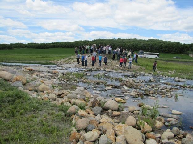 Tour visiting Pelly's Lake Dam
